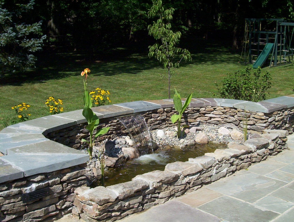 Stone Patio, Water Feature and Landscaping Project in Potomac, MD