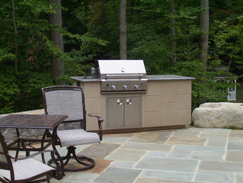 Stone Patio, Outdoor Kitchen and Water Feature in Bethesda, MD